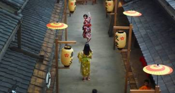 People dressed in kimono pose for photographs in the museum
