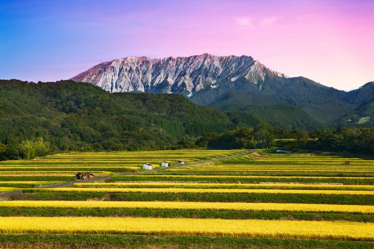 Mt. Daisen at dusk with a foreground of rural land.