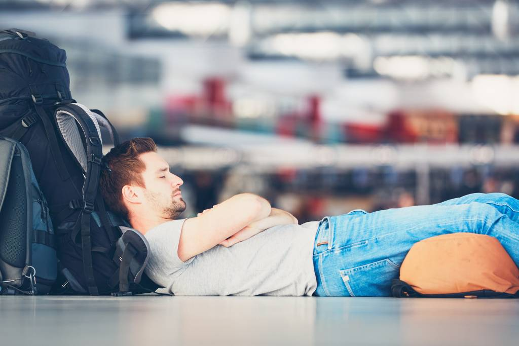 Traveler sleeping in airport