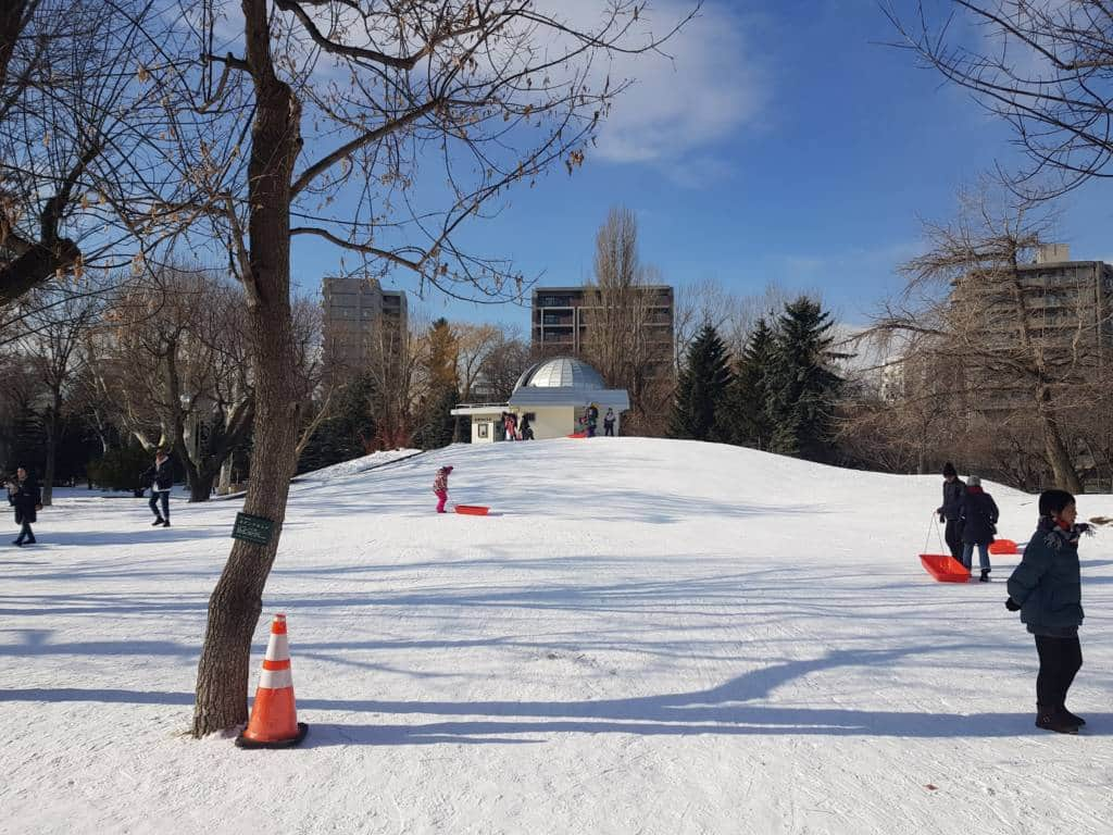 Sledding with observatory in background