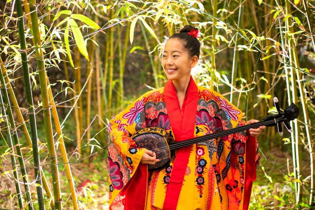 Girl playing sanshin
