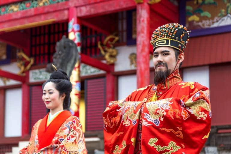 The King and Queen in full costume at Shuri Castle
