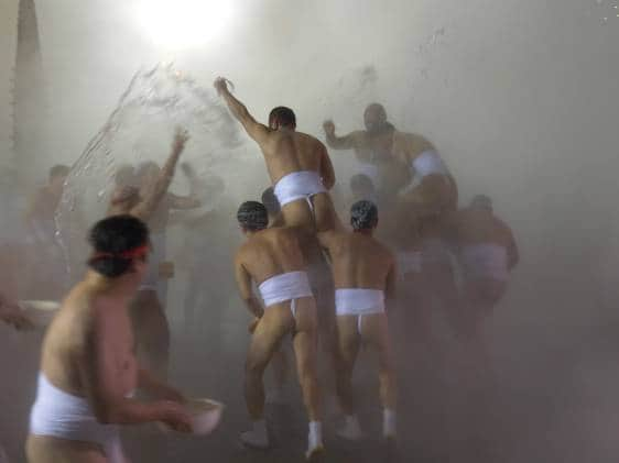 Men in fundoshi battle at the Noboribetsu Naked man Festival
