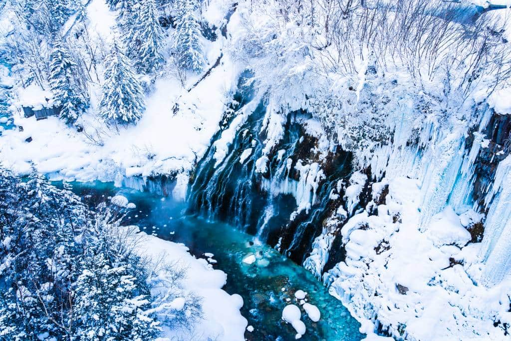 Beautiful outdoor nature landscape with -shirahige waterfall and bridge in snow winter season Hokkaido Japan - Japan winter natural wonders