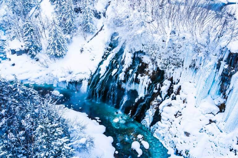 Beautiful outdoor nature landscape with shirahige waterfall and bridge in snow winter season Hokkaido Japan