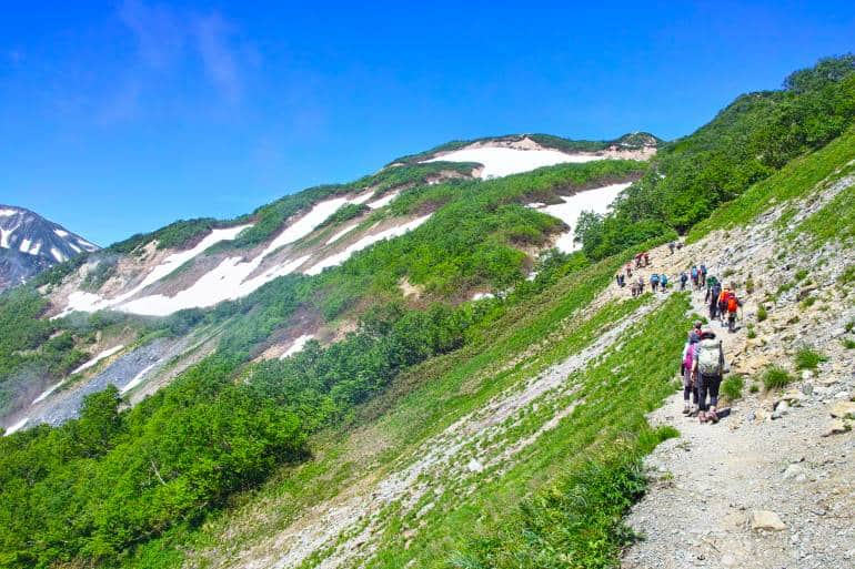 Happo-one mountain hikers in summer