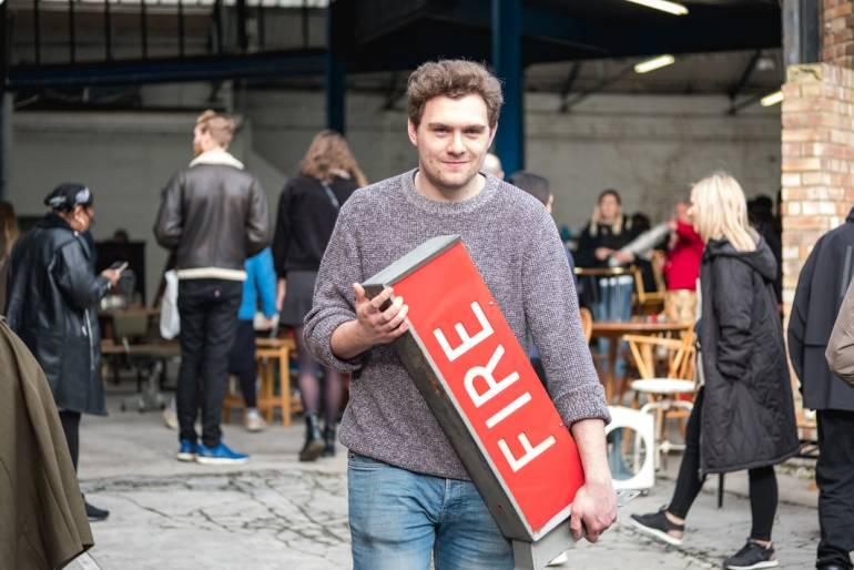 Man with Fire sign at Peckham Flea Market