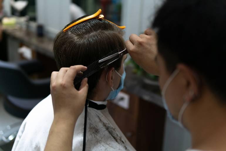 hair cut with masks on