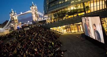 People watching an open air film screening in London
