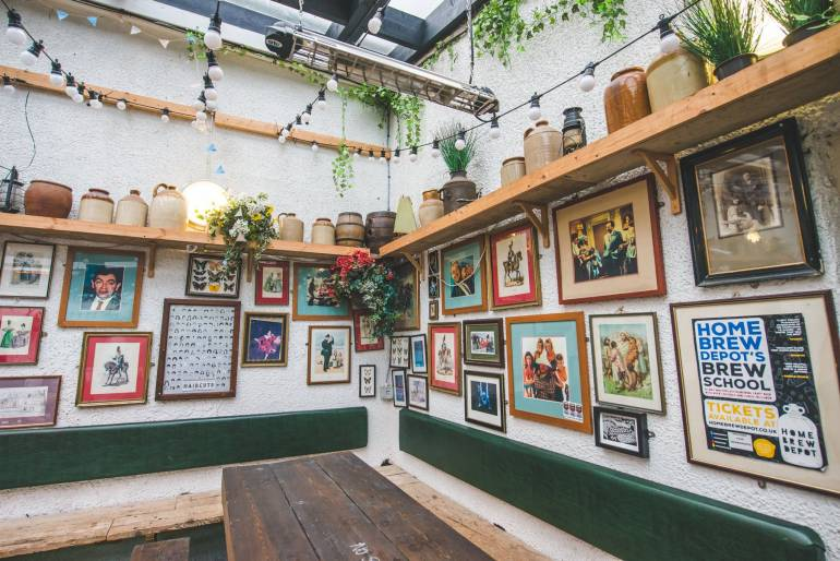 Corner of pub with pictures on the wall