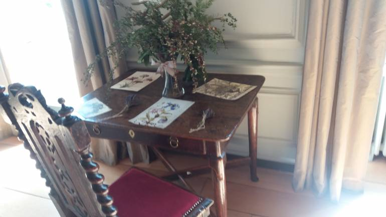 A beautiful old table with flowers on