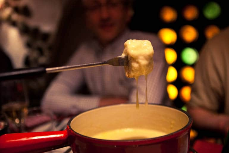 A fondue pot of melted cheese