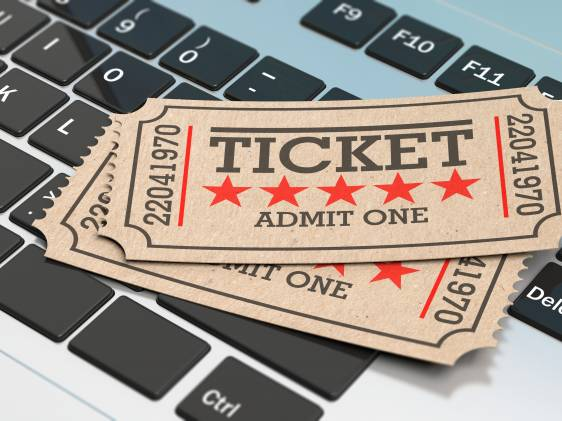Old-timey cinema ticket on laptop keyboard