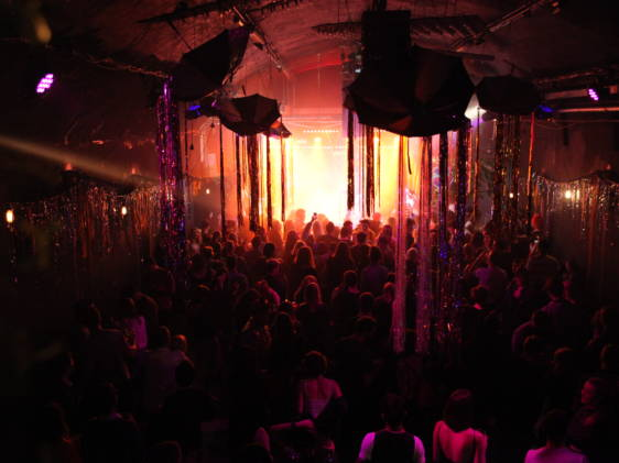 a cabaret show in a low lit room
