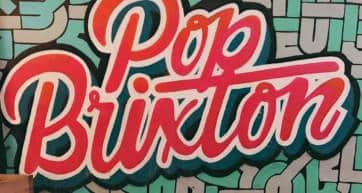 A graffiti style sign for a venue