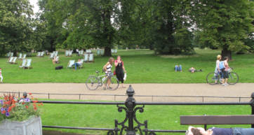 People on deck chairs in Hyde Park