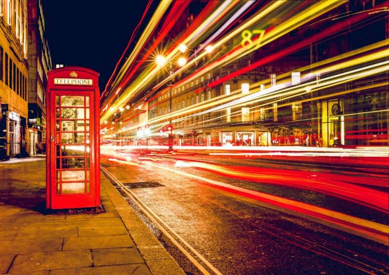 a red telephone booth on a London street to introduce UK SIM cards