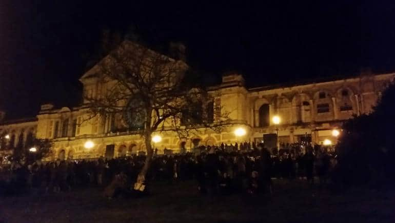 People gathered at a venue at night