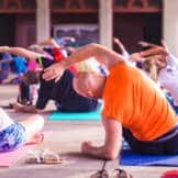 A group of people practicing Yoga