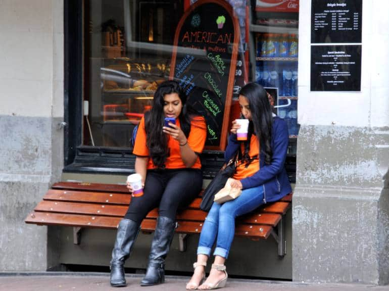 Girls talking outside bakery