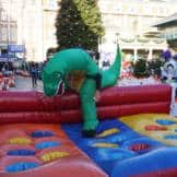 People on an inflatable obstacle course