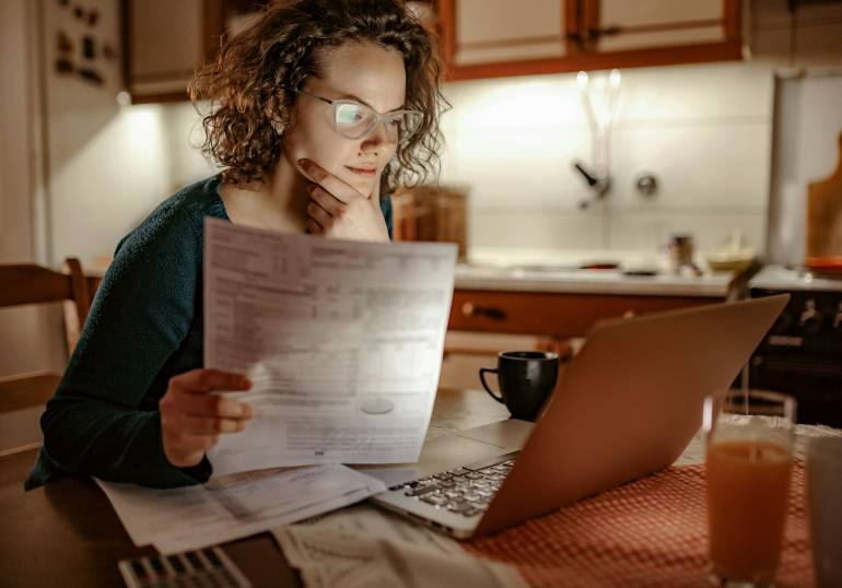 Woman switching energy providers paying bills