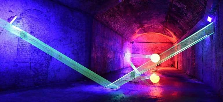 A colourful neon-lit tunnel