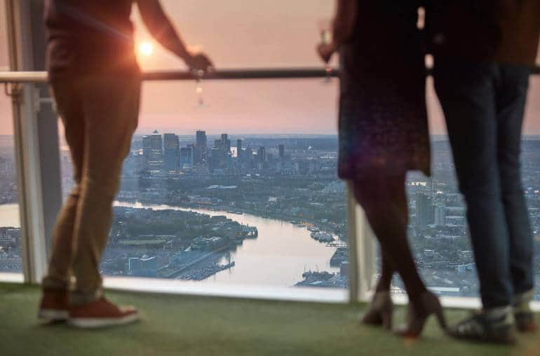 View from the shard at dusk, viewers with champagne glasses