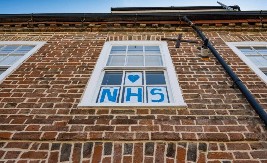 NHS sign in a window - UK healthcare