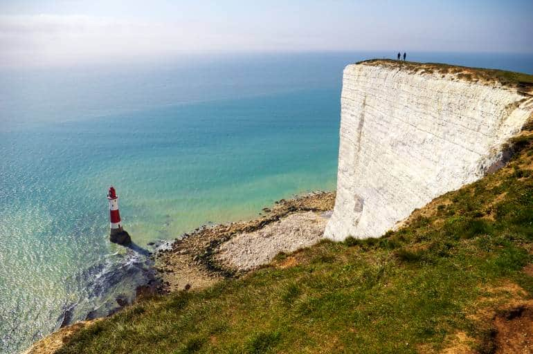 Lighthouse below the coastal cliffs called Seven Sisters in UK