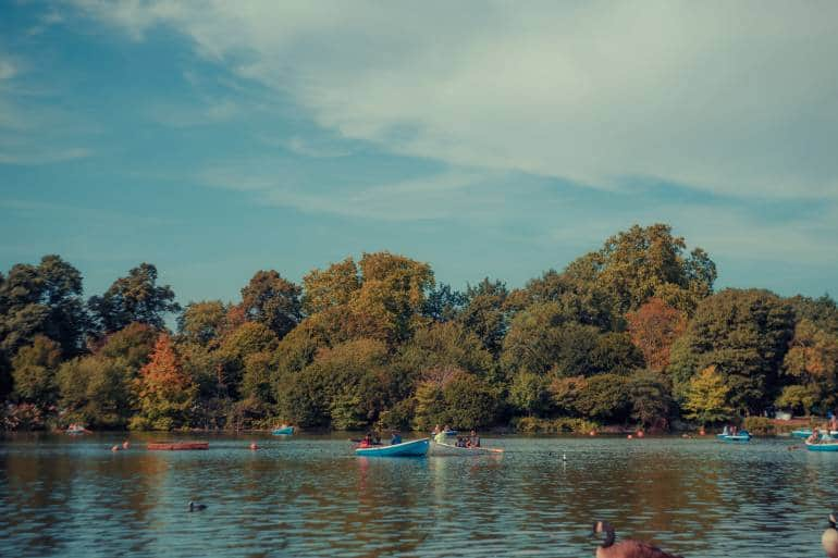Victoria Park lake with autumn trees and boaters
