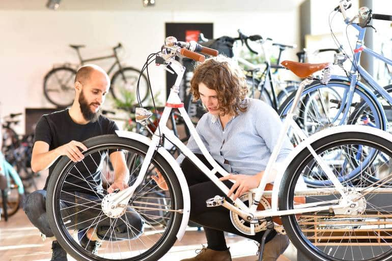 customer and sales associate in a bicycle shop