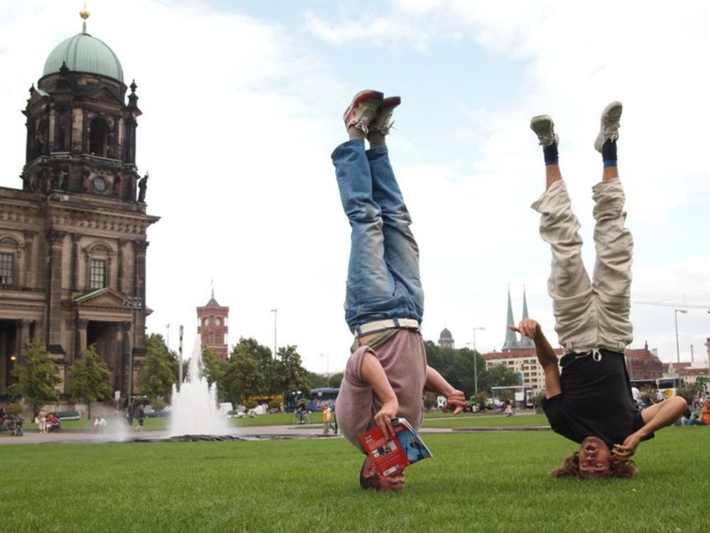 Alex and Chris Kirkland arguing over directions in Berlin whilst standing on their heads