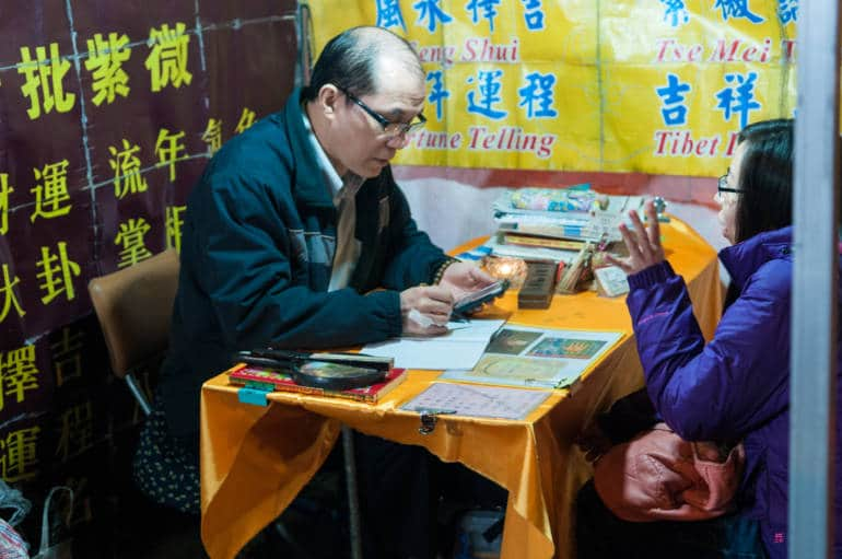 Fortune teller at Temple Street Night Market in Hong Kong