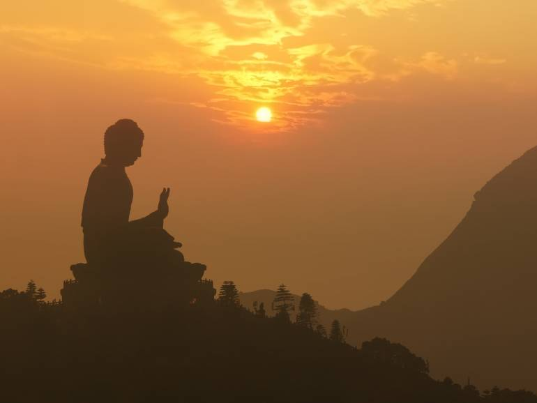 Tian Tan Big Buddha statue silhouette at sunset