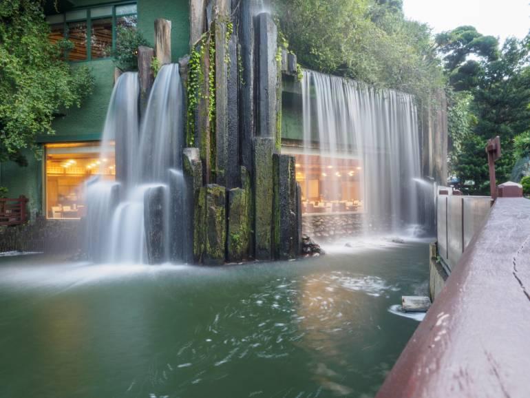 restaurant behind waterfall