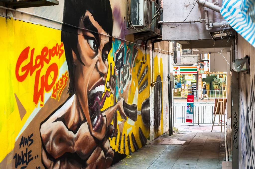 Graffitied mural of Hong Kong martial arts legend Bruce Lee in Wan Chai, Hong Kong