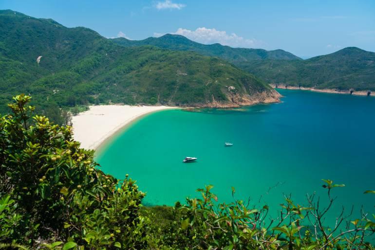 Boats near the secluded Long Ke Wan beach in Hong Kong