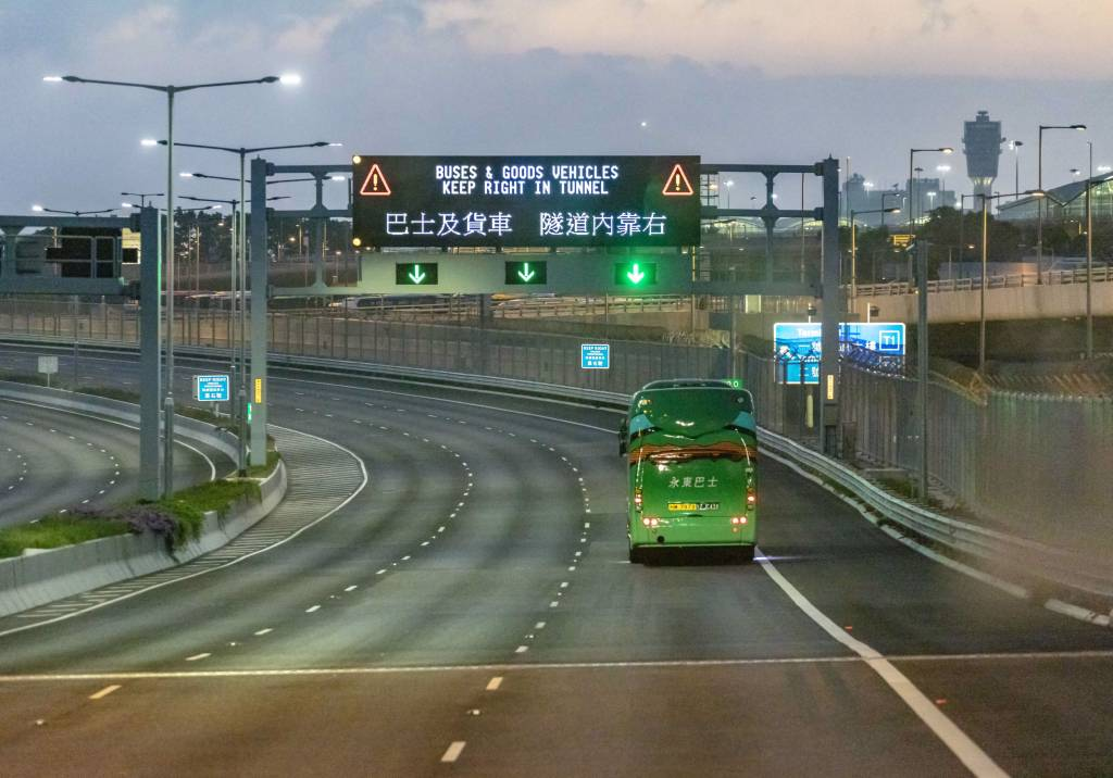 A green bus crosses the Hong Kong Zhuhai Macau Bridge.