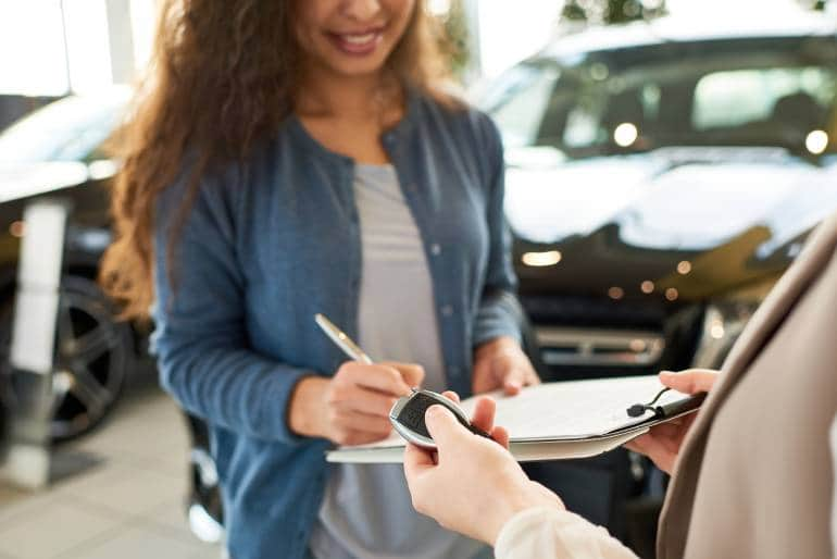 signing contract at car rental company
